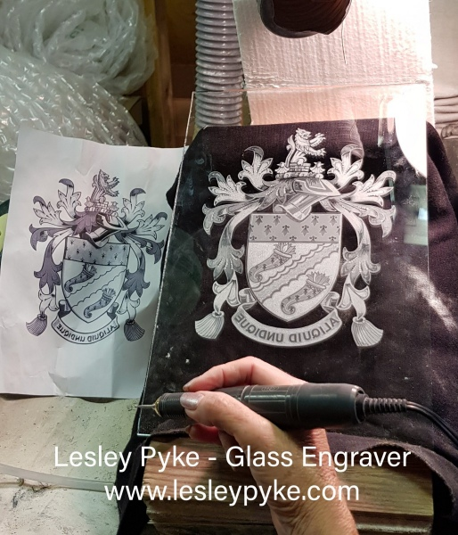 Engraved family arms, window panel