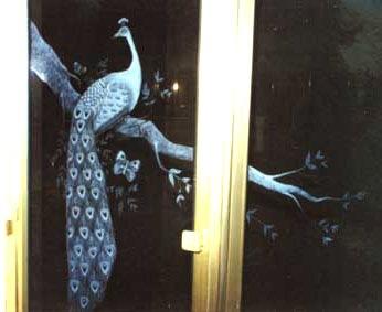 Engraved peacock on shower doors